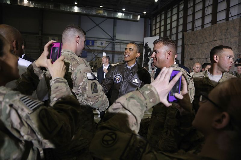 Soldiers take photos as U.S. President Barack Obama shakes hands with troops after delivering remarks at Bagram Air Base in Kabul