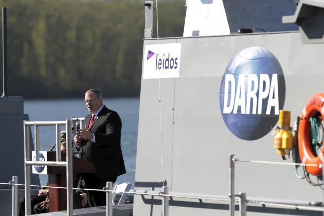 "Robert Work, U.S. Deputy Secretary of Defense, speaks at a christening ceremony for the autonomous ship ""Sea Hunter"", developed by DARPA, in Portland, Oregon before its christening ceremony April 7, 2016.  REUTERS/Steve Dipaola"